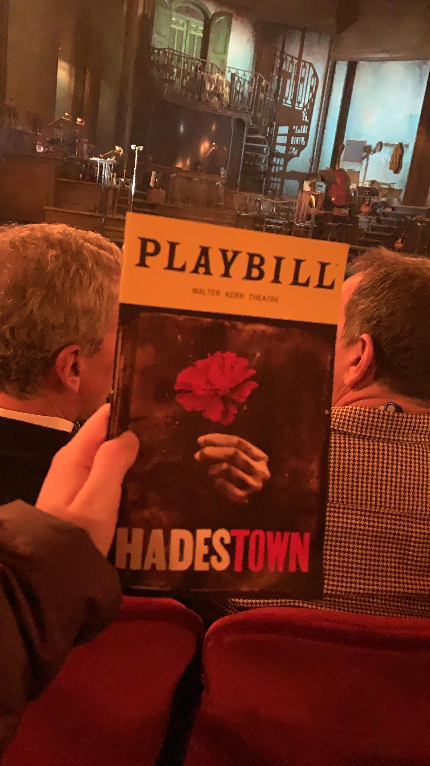 Hadestown playbill in front of stage