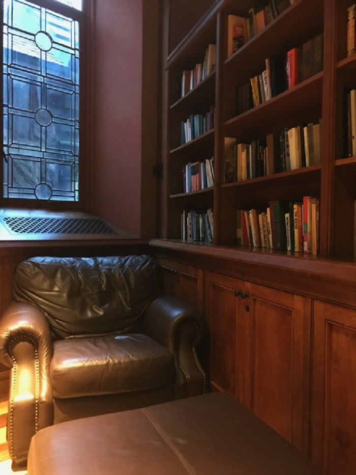 Leather chair in the corner next to a bookshelf