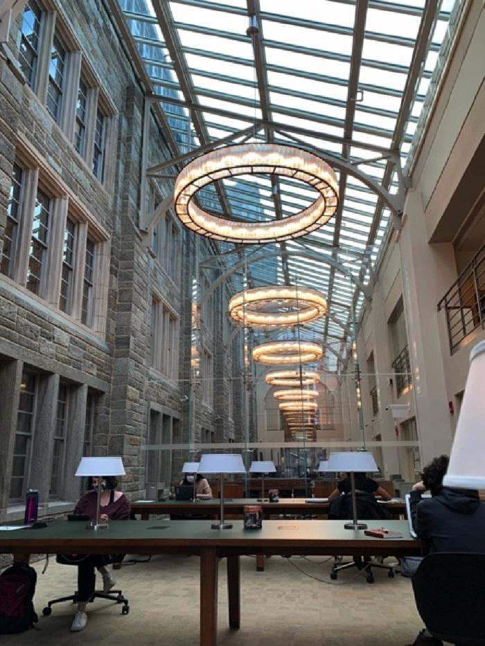 Atrium of Firestone Library with long tables and bright lights