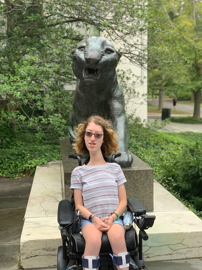 Naomi in front of metal tiger statue