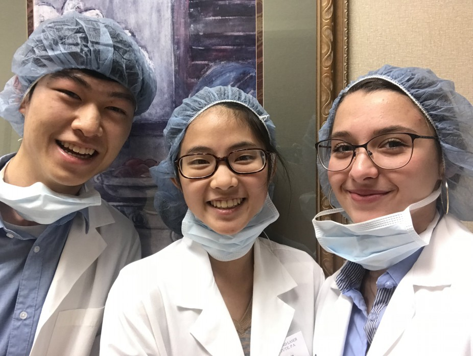 Three student interns at the Cornea Laser and Eye Institute