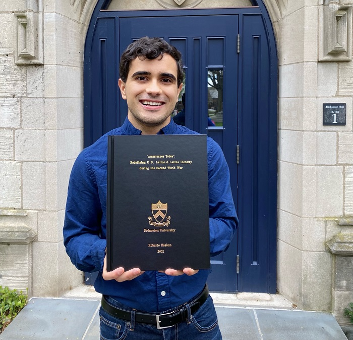 Rob standing with his bound senior thesis