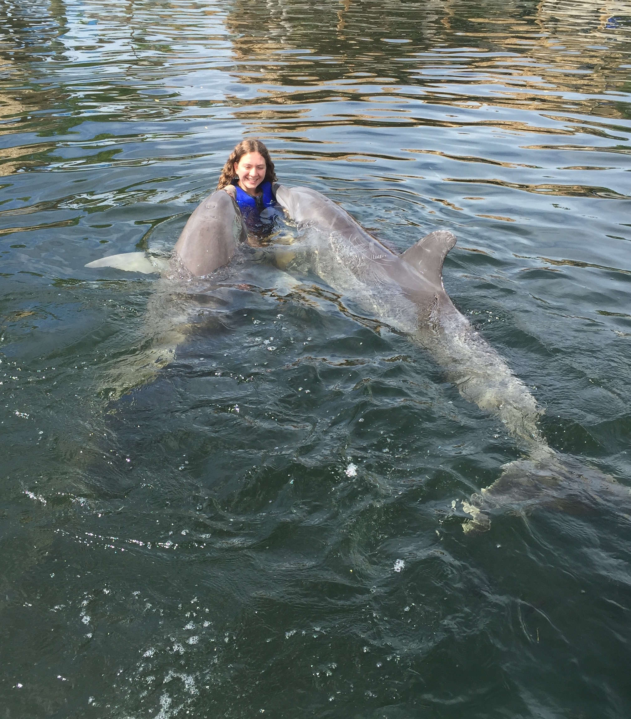 Michelle with two dolphins