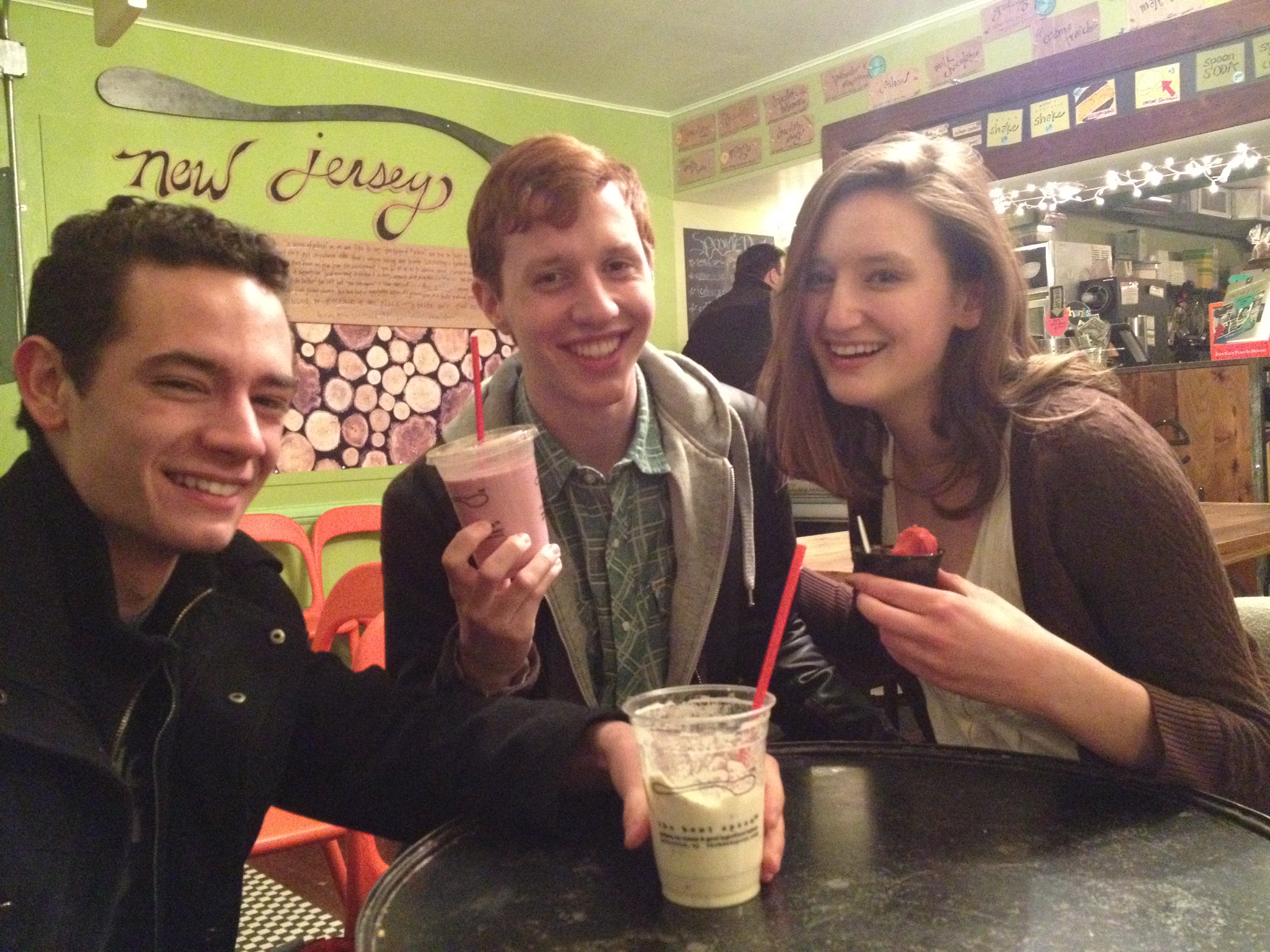 Three of my friends in Bent Spoon, showing off their milkshakes and ice cream.