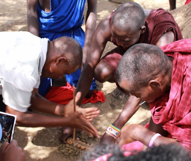 Maasai community teaching students how to start a fire