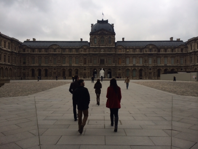 The members of l'Avant-Scène, strolling through the courtyard of the Louvre.