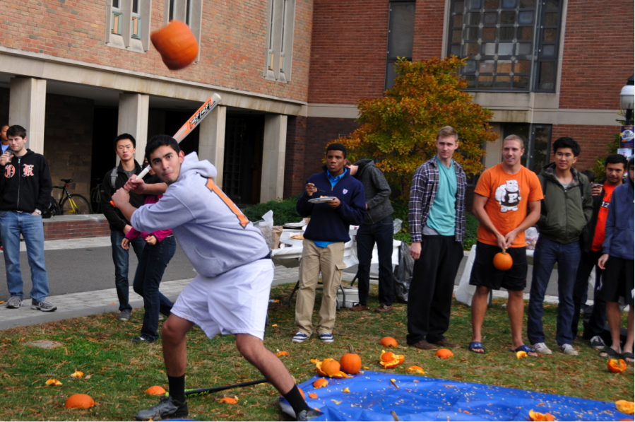Student preparing to hit pumpkin