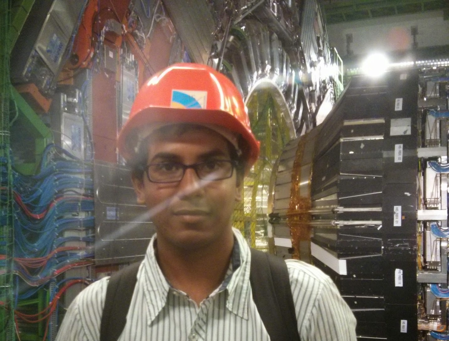 Me standing in front of the Compact Muon Solenoid