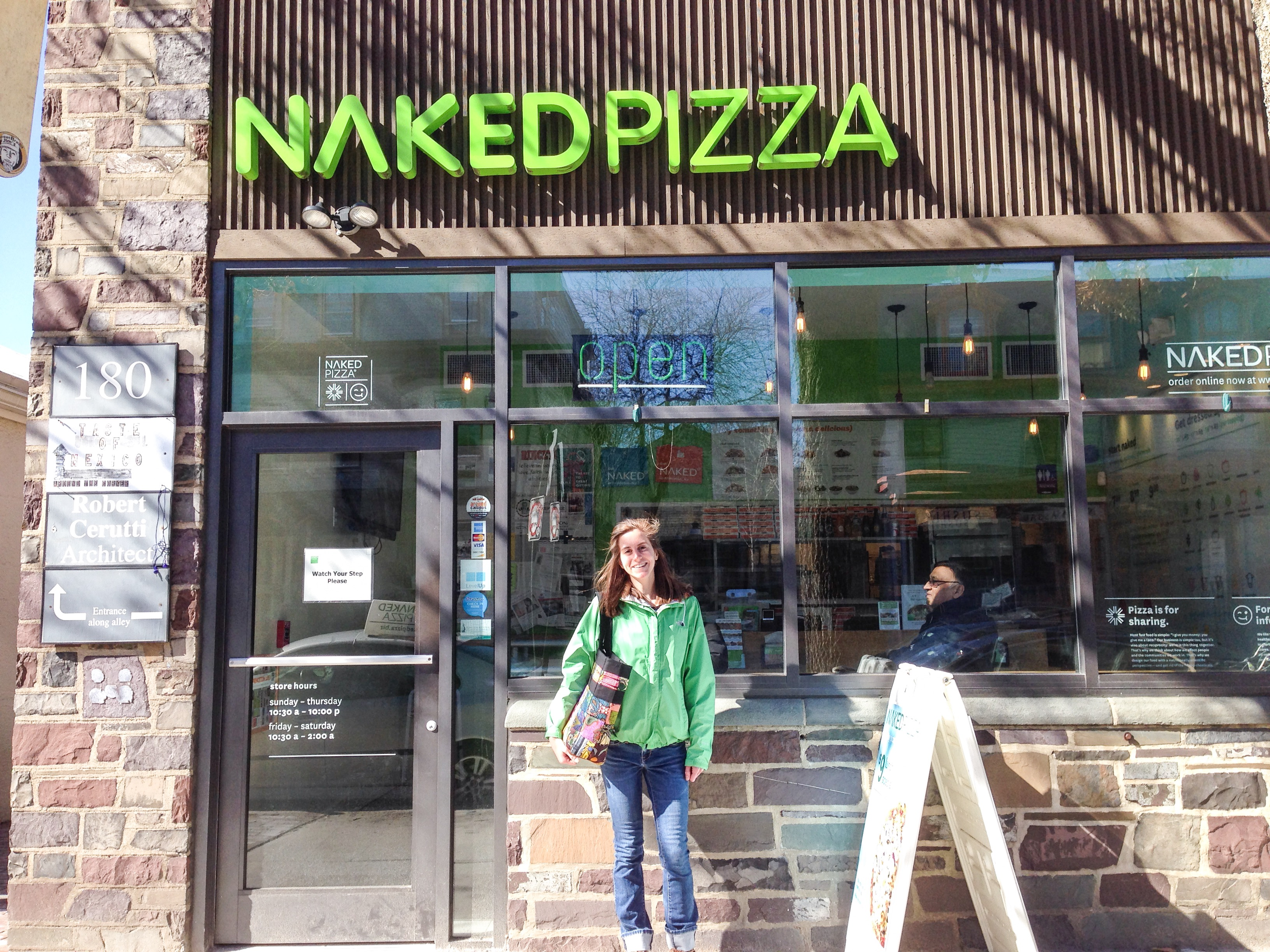 This is a picture of me outside of Naked Pizza.