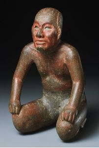 Kneeling lord with incised toad on his head