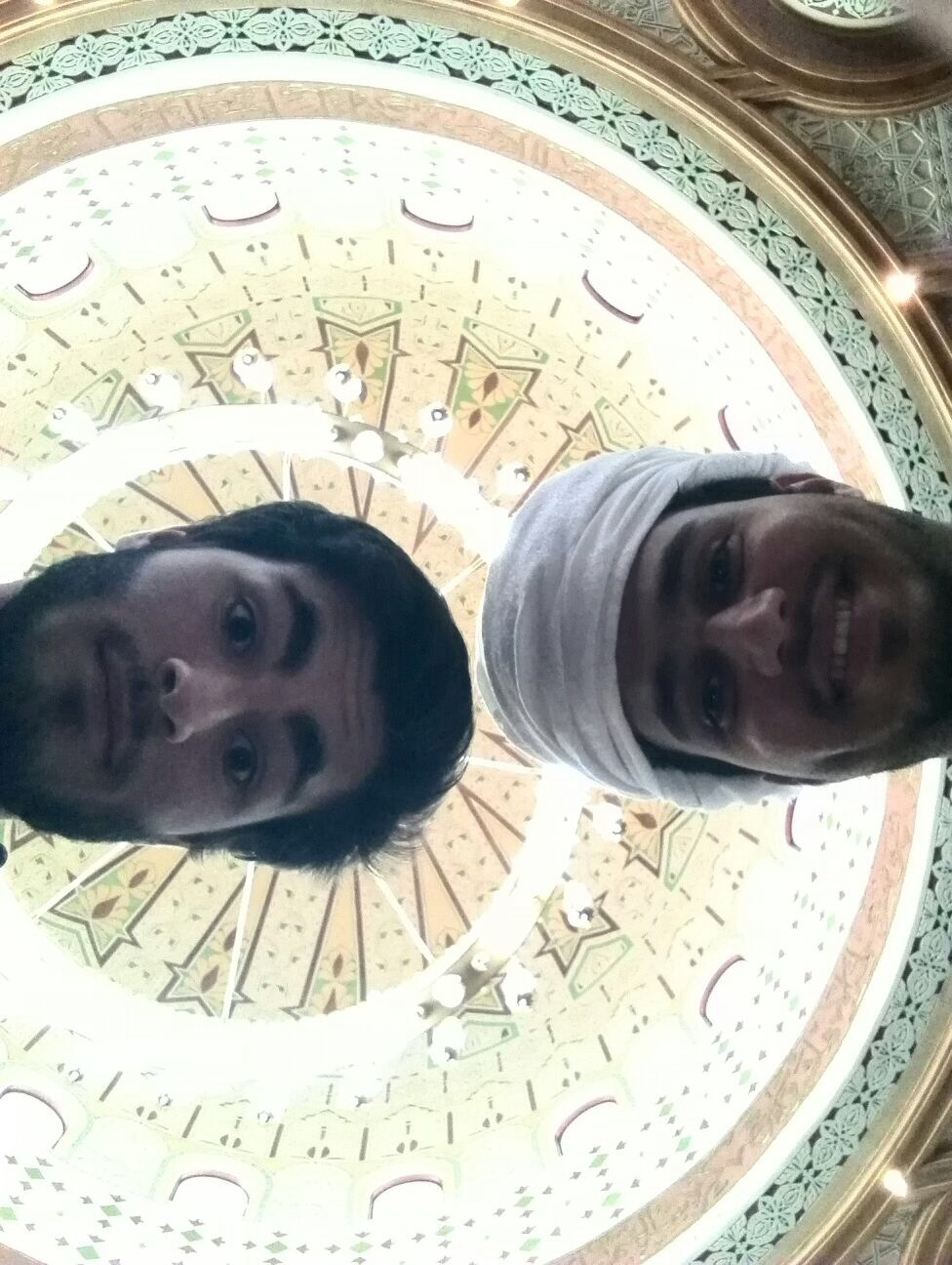 My language partner, Ahmed, and I with the ornate ceiling of a mosque above us.