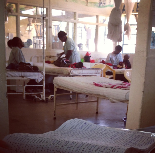 Image of pediatric ward, with mothers attending to their children