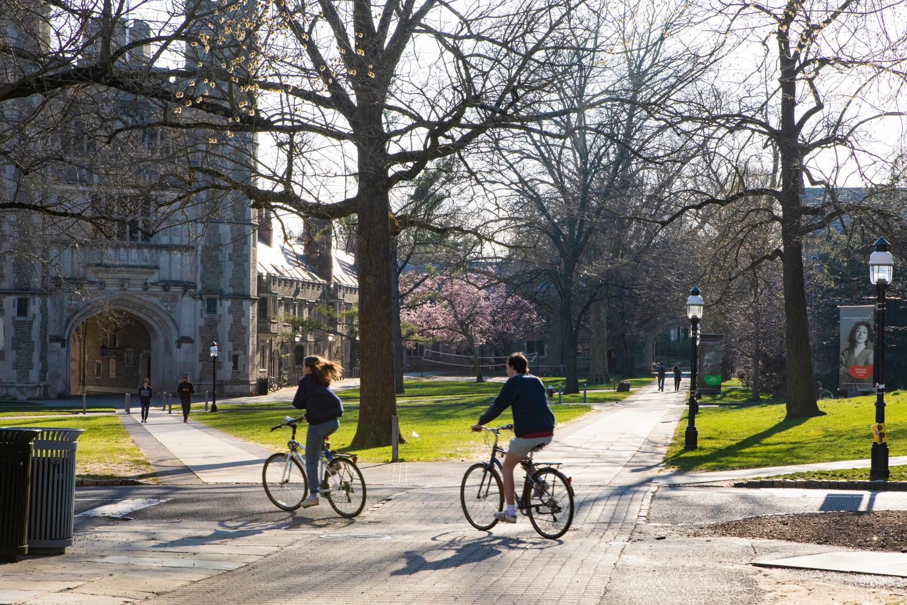 Students riding bikes on campus