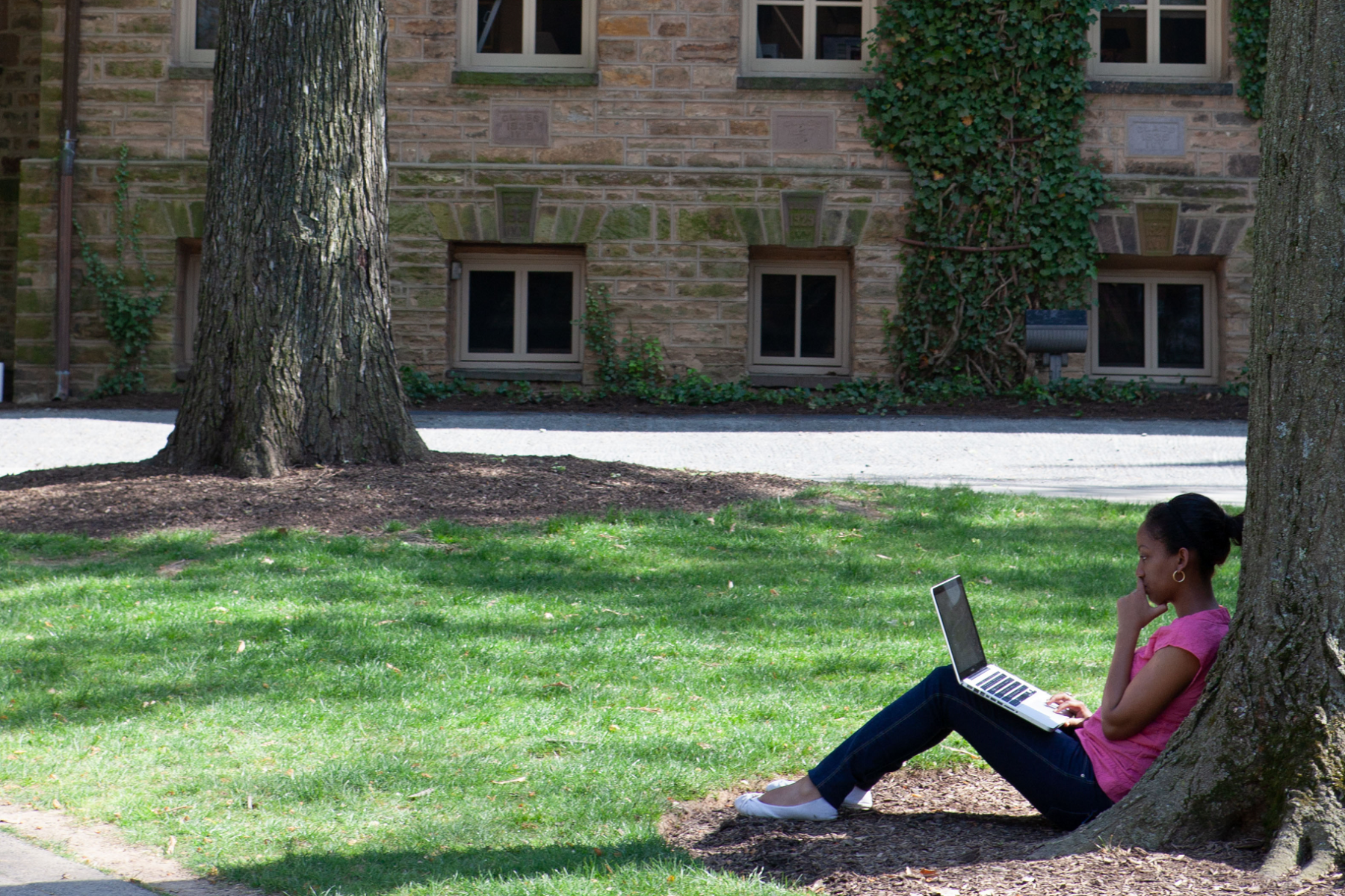 Student studying in front of Nassau Hall
