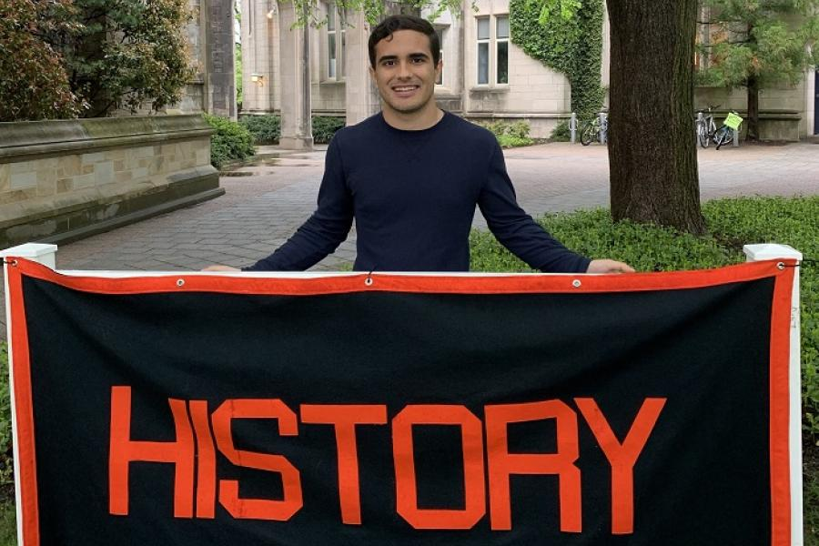 Rob standing behind the History concentration banner