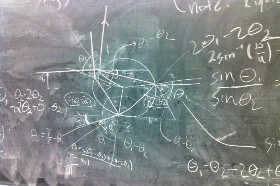 A blackboard with drawings and equations