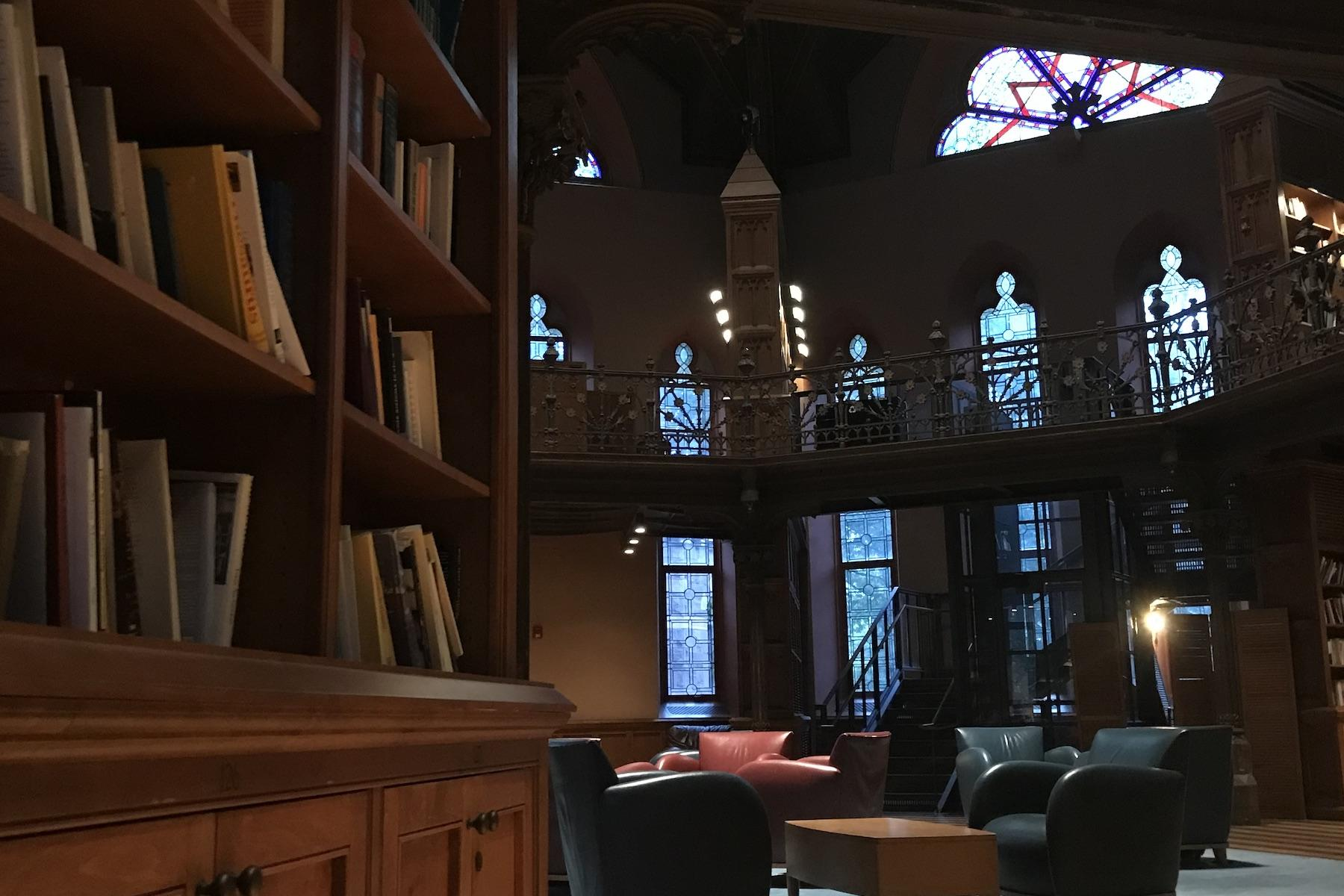 Picture of Chancellor Green Library, a room with bookshelves, chairs, and stained glass windows