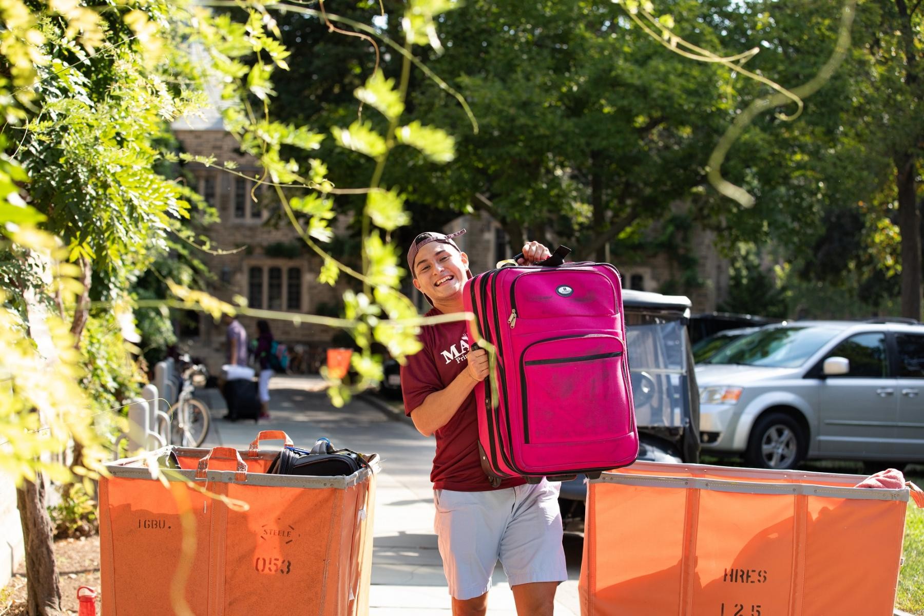 Student with a suitcase on move-in day