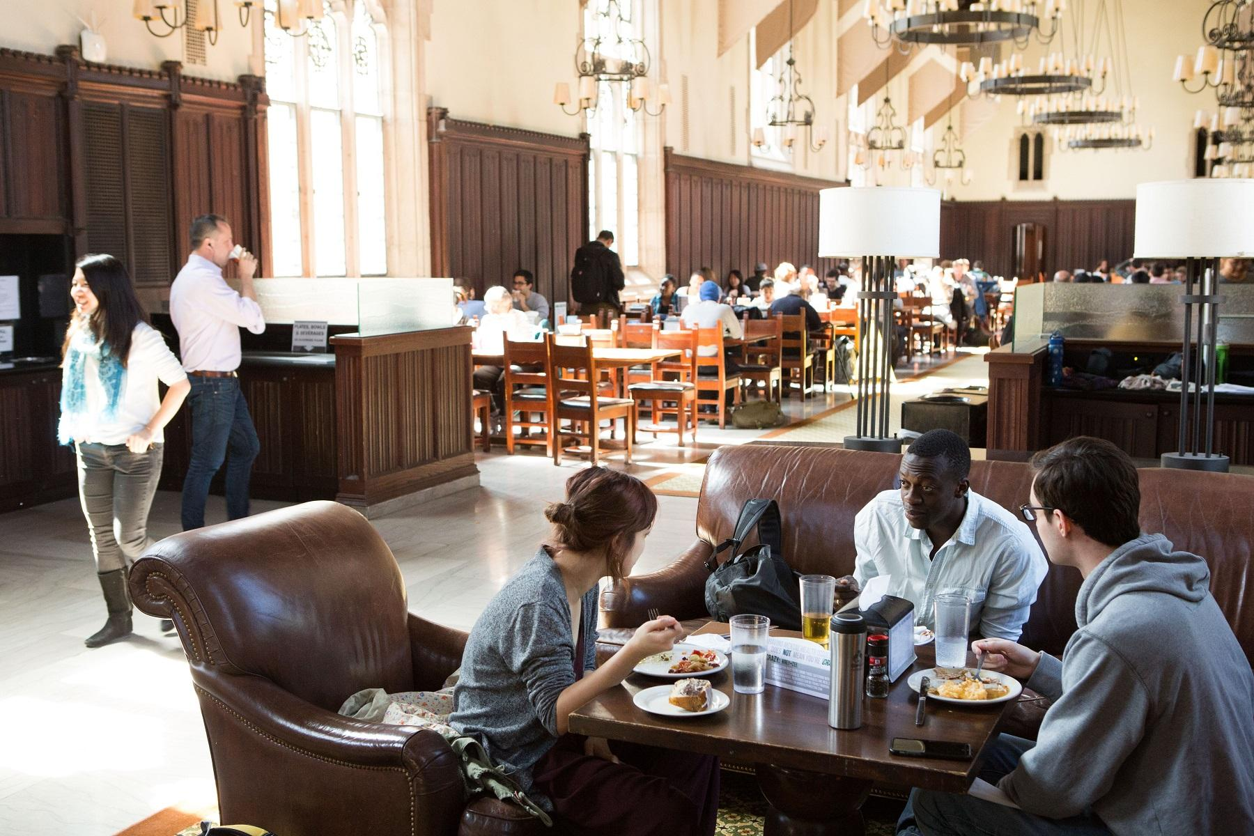Students sitting together in the Rocky/Mathey dining hall eating