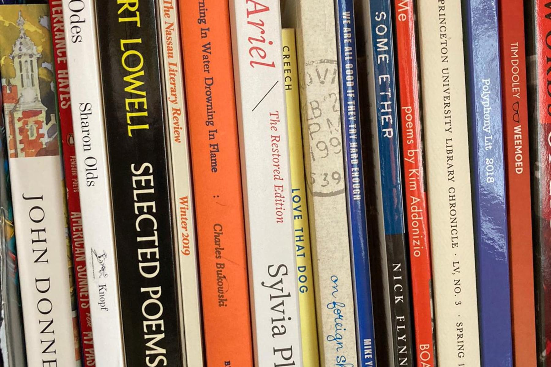 A bookshelf lined with poetry collections from Robert Lowell, John Donne, and Sharon Olds, among others.