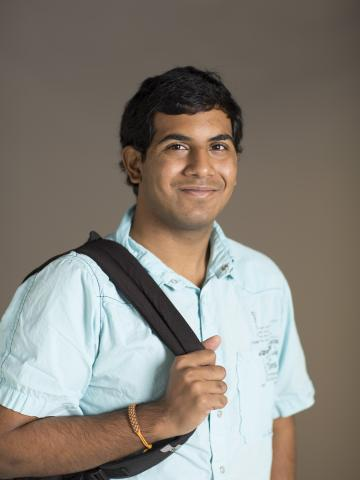 Avaneesh Narla standing holding backpack