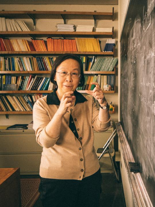 Sun-Yung Alice Chang standing in front of chalkboard