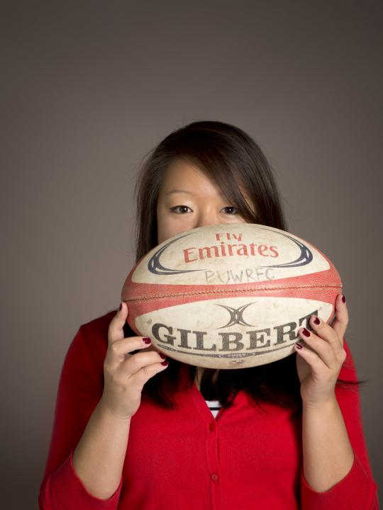 Wendy Li holding a football